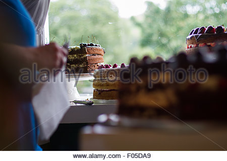 Some beautifully large cakes on sale at a local cafe in the Lake District - Stock Photo