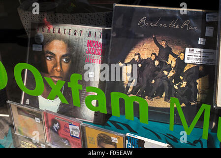 Vinyl records and CD's for sale in the window of an Oxfam charity shop in Edinburgh. - Stock Photo