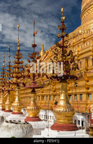 Gilt stupas in front of main stupa of Shwezigon pagoda, Nyaung U, near Bagan, Myanmar - Stock Photo