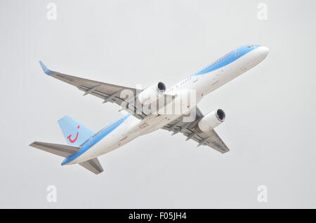 TENERIFE, SPAIN - JUNE 3: A Thomson Holidays Boeing 757 taking off from Tenerife south airport on a cloudy day on - Stock Photo