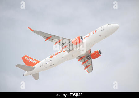 TENERIFE, SPAIN - JUNE 3: Scenic view of an Easy Jet Airbus A320-200 taking off from Tenerife south airport on a - Stock Photo