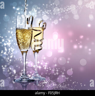 Two champagne glasses over shiny purple background - Stock Photo