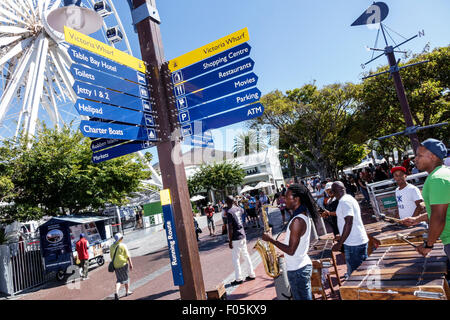 Cape Town South Africa African V & A Victoria Alfred Waterfront directions sign musicians performing - Stock Photo