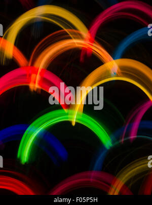 Rainbows of Multi-colored Light Abstract in Green Red Yellow Orange and Blue for Background or Web Template - Stock Photo