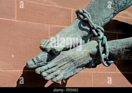 The Devils feet bound in chains (Michael and the Devil) on the wall of the new Cathedral, Coventry, West Midlands, - Stock Photo