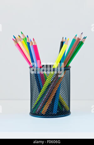 Pencils in a case on the light-coloured shelf - Stock Photo