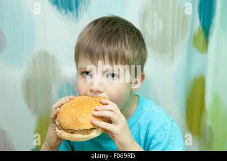boy with burger - Stock Photo