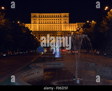 View of Romanian parliament from fountains in Unirii Boulevard, Bucharest, Romania - Stock Photo