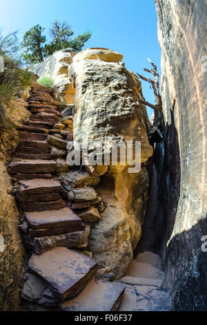 A long stretch of the Joint Trail in the Needles District takes hikers through a slot canyon in Canyonlands National - Stock Photo