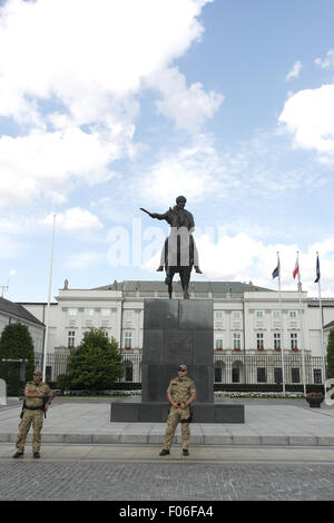 Blue sky white clouds portrait two soldiers standing in front of Prince Jozef Poniatowski Monument, Presidential - Stock Photo