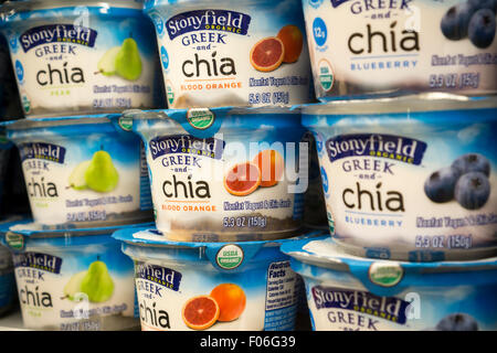 Containers of Stonyfield organic Greek style yogurt with the addition of Chia seeds, another popular food fad item, - Stock Photo