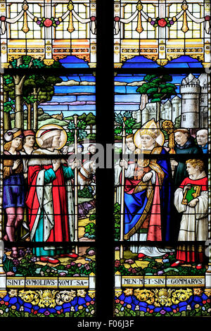Detail of a stained glass window depicting Saint Rumbold at Saint Rumbold's Cathedral (1312) in Mechelen, Belgium - Stock Photo