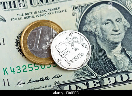 Russian rubles coin, euro and dollars banknotes close up - Stock Photo