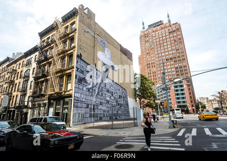 New York, NY - 8 August 2015 - Mural by street artist JR adorns the side of  a TriBeCa loft building in Lower Manhattan - Stock Photo