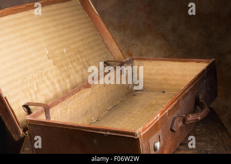 View inside a very old brown antique suitcase - Stock Photo