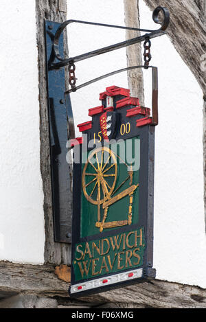 Sign of the Sandwich Weavers Guild on a historic medieval timber framed building. - Stock Photo
