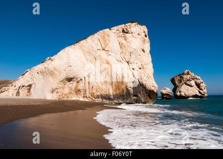 Famous touristic landmark Aphrodite's rock and empty pebble beach Petra tou Romiou at summer. Cyprus - Stock Photo