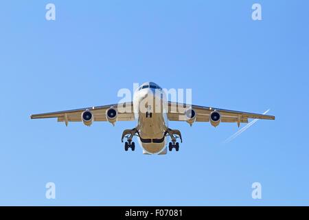 Airplane landing in Zurich airport - Stock Photo