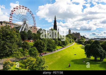 Princes Street Gardens, Edinburgh with a view to Scott Monument and the Princes Street Ferris wheel. Scotland, UK - Stock Photo