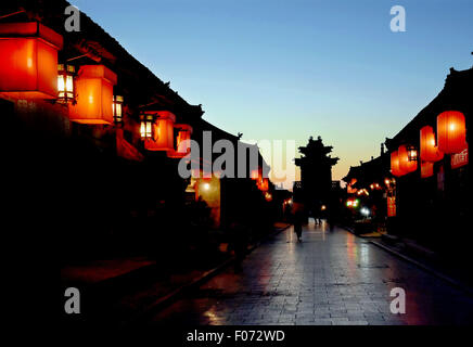 Beijing, China. 8th Dec, 2014. Photo taken on Dec. 8, 2014 shows the night view of Pingyao ancient city, north China's - Stock Photo
