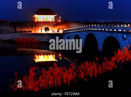Beijing, China. 8th Dec, 2014. Photo taken on Dec. 8, 2014 shows the night view of a gate of Guangfu ancient city - Stock Photo