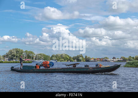 Transport of plant spraying equipment across Westeinderplassen, a complex of lakes at Aalsmeer, North Holland, The - Stock Photo