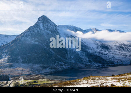High view across Ogwen Valley to Mount Tryfan mountain peak and Glyderau mountains from Carneddau in winter. Snowdonia National Park Wales UK