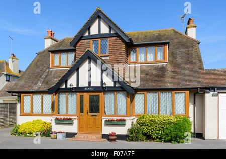 1930's 2 storey detached house in Mock Tudor style with double-glazed windows in West Sussex, England, UK. - Stock Photo