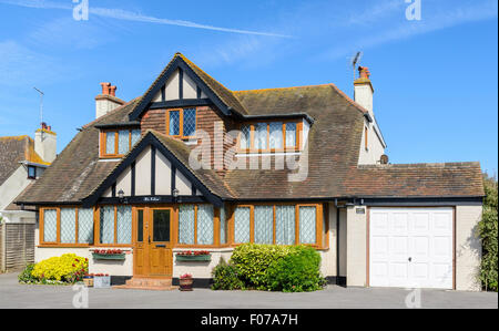2 storey detached house in Mock Tudor style with double-glazed windows and a garage in West Sussex, England, UK. - Stock Photo