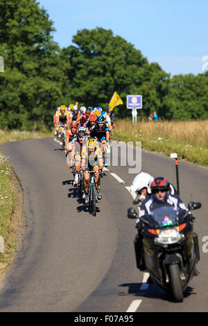 The peloton passes through Ranmore Common during the Prudential RideLondon-Surrey Classic 2015 - Stock Photo