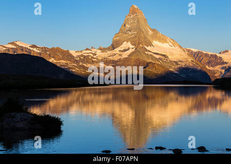 Sunrise on Mt.Matterhorn (Cervino).  Lake Stellisee, Zermatt, Switzerland - Stock Photo