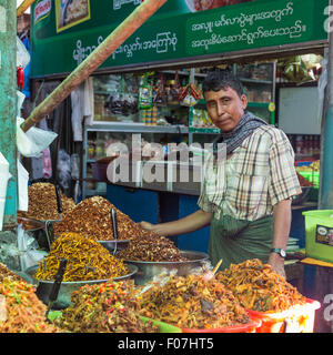 Spice and prepared food merchant at food market, Pyin Oo Lwin, Myanmar - Stock Photo