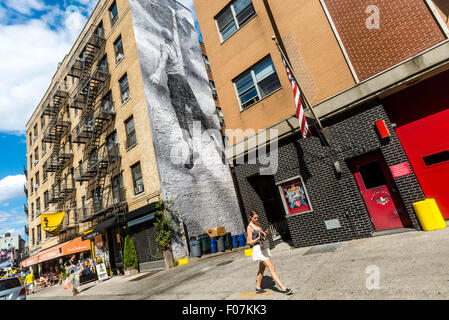 New York, NY - 9 August 2015 - Mural by street artist JR adorns the side of  a  NoLiTa apartment building in Lower - Stock Photo