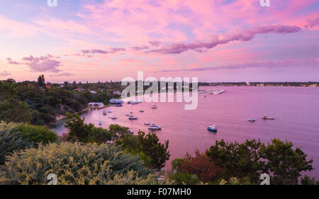 Looking down over Freshwater Bay, Peppermint Grove,  the yacht club and the Swan River at sunset. Western Australia - Stock Photo