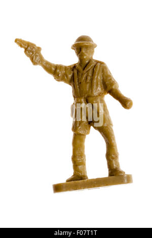 Airfix HO/OO plastic model soldier figure. World War Two, 8th army. Plain background. Officer firing pistol - Stock Photo