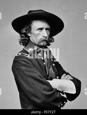 Brevet Major General George Armstrong Custer in field uniform circa 1865. Unattributed photograph. - Stock Photo