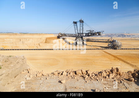 A giant Bucket Wheel Excavator at work in an endless lignite pit mine - Stock Photo