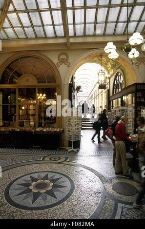 People at Galerie Vivienne passage in Paris, France - Stock Photo