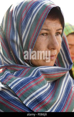 Close-up of woman wearing headscarf in Camara de Lobos, Madeira, Portugal - Stock Photo