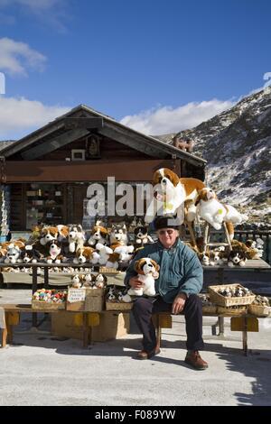 Giuseppe Vuyet front of kiosk at Great St. Bernard Pass in Valais, Switzerland - Stock Photo