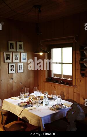 Laid table in Hotel Flachauerhof, Austria - Stock Photo