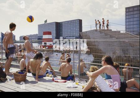 Tourists at outdoor pool in Sydhavnen, Copenhagen, Denmark - Stock Photo
