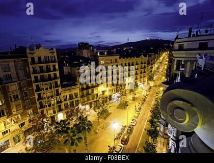 View of buildings and street lights at evening in Gracia, Barcelona, Spain - Stock Photo