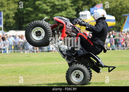 Royal Signals White Helmets Motor cycle Display Team performing stunts at the Halifax show in August 2015 - Stock Photo