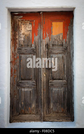 Old door in the town of Chora on Patmos island in Greece. - Stock Photo