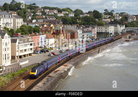 A First Great Western HST passing along along the sea wall at Dawlish - Stock Photo
