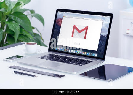 Varna, Bulgaria - May 29, 2015: Google Gmail logo on the Apple MacBook Pro display that is on office desk in office - Stock Photo