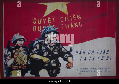 old propaganda poster showing vietcong soldiers - Stock Photo