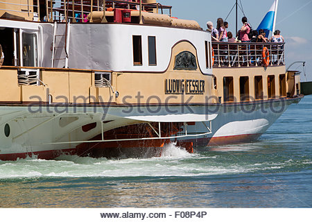Visitors on a steamship at lake Chiemsee in Bavaria, South Germany - Stock Photo