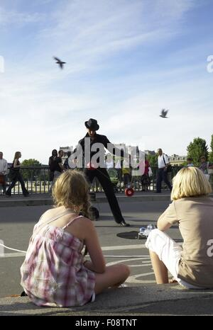 Juggler performing on Pont Saint-Louis bridge in Paris, France - Stock Photo